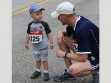 Two-year old Jude Katen gets some words of advice from dad just before going to the starting line. He ran the whole race!