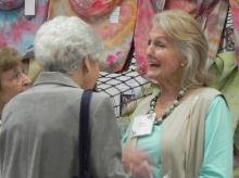 Denise Robison Mullen makes sure she is in Erie each year to catch up with friends like Sue Wressel at Taste of the Arts.