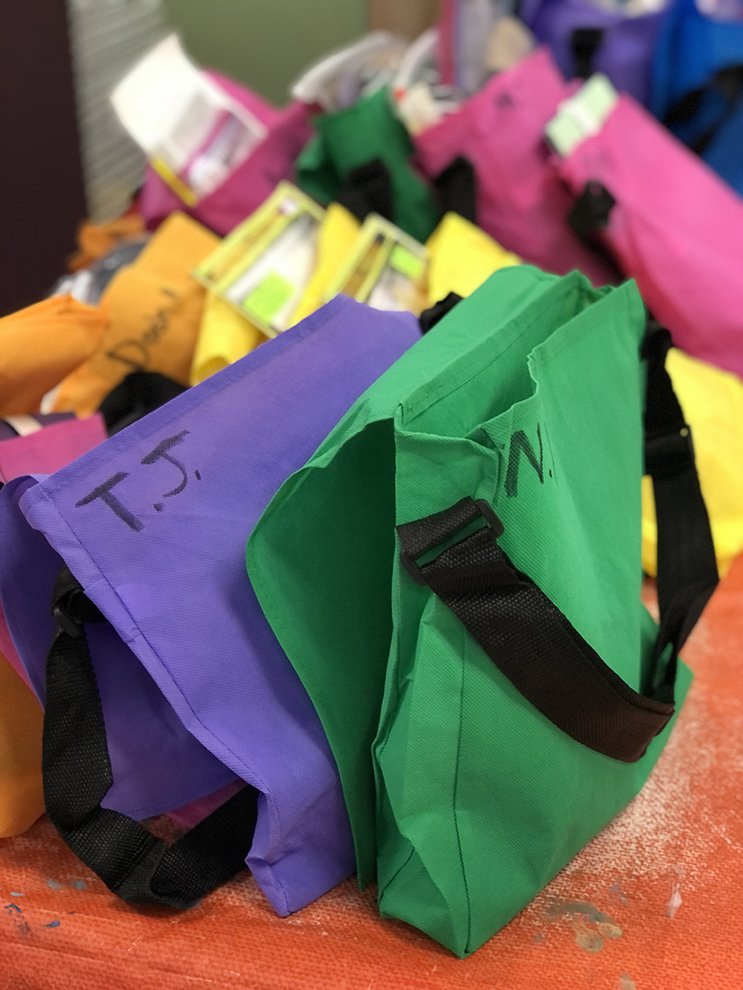 Bags of art supplies to be picked up by Art House families for their virtual classes.